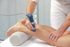 shockwave therapy applied to leg